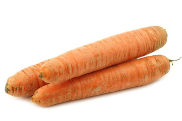 three winter carrots on a white background