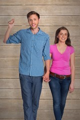 Composite image of full length of happy young couple