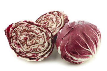 "red ""radicchio"" lettuce and two halves on a white background"