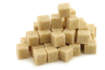 sugar cane cubes on a white background