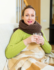 Woman with scarf dissolving medicine