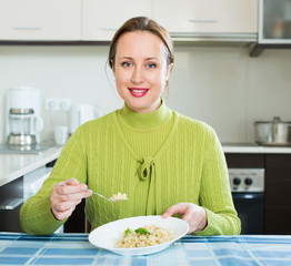 woman eats rice