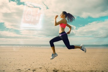Composite image of full length of healthy woman jogging on beach