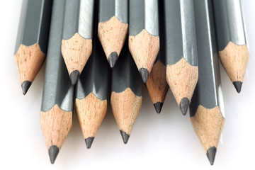 a bunch of drawing pencils on a white background