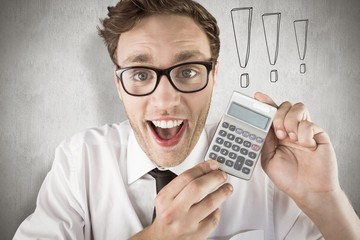 Composite image of geeky businessman showing a calculator