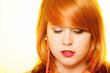 Redhair girl portrait wearing sweet jelly candy earrings