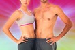 Composite image of mid section of a fit young couple