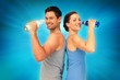 Composite image of happy fit young couple with water bottles