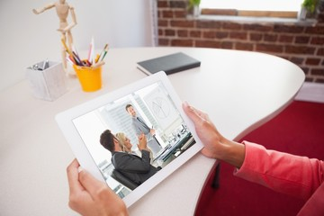 Composite image of business people in office at presentation