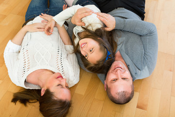 Family smiling at the floor