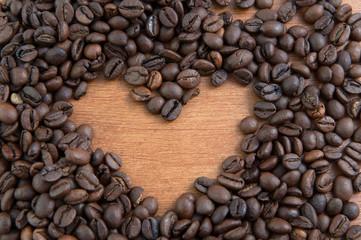 Coffee heart on wooden mat