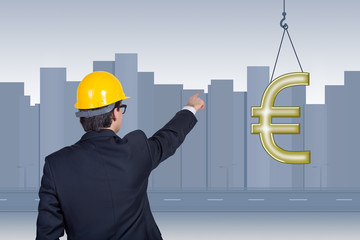 businessman pointing to euro symbol