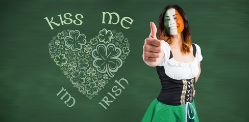 Composite image of irish girl showing thumbs up