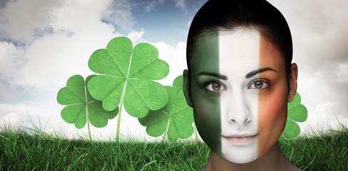 Composite image of brunette in irish face paint