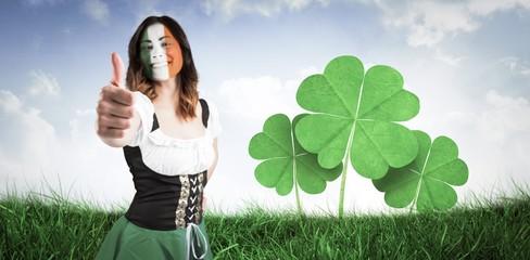 Composite image of irish girl showing thumbs up