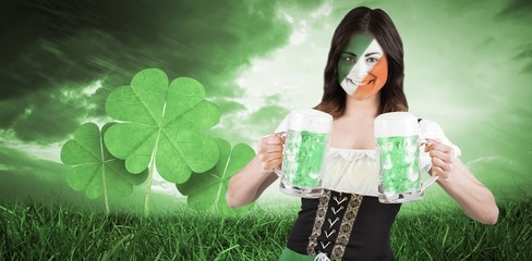 Composite image of irish girl with beer