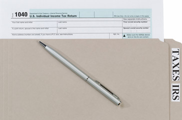 Individual income tax form with ink pen and folder