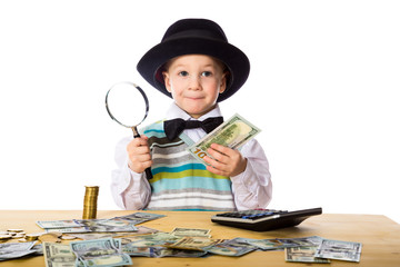 Little boy counting money on the table