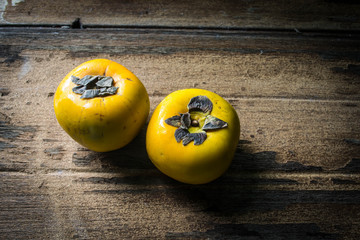 persimmon on a wooden