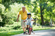 grandfather and child have fun  in park - 78797143