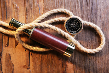 Marine still life spyglass, compass and rope