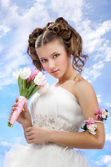 Smiling Bride Standing with a Spring Bouquet