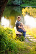 Father with his little baby sitting on wooden bench