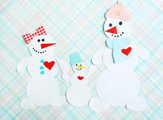 Handmade snowmen on bright background