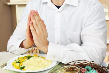 Man praying before eating