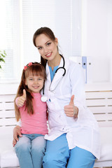 Little girl and young doctor in hospital