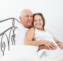 enior  man and   woman  on   bed