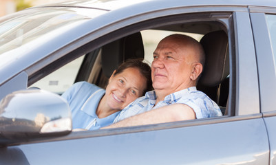 man taking his wife in  car.