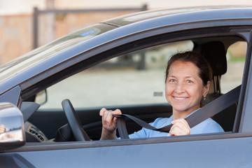 Senior woman  in   car.