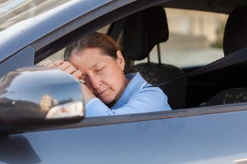 woman sleeping in   car.