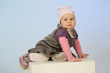 cute little baby girl posing in a studio
