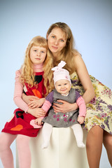 mother and two daughter in a studio