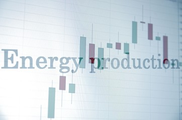 "Inscription ""Energy production"" on PC screen. Financial concept."
