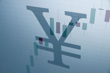 Japanese yen sign & stock chart on PC screen.