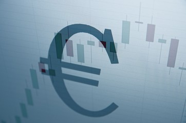 Euro sign & stock chart on PC screen.
