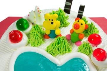 Fancy cake closeup with sugar cartoon