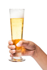 Hand holding a glass of cold beer with white background