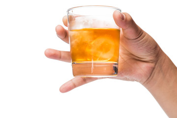 Hand holding a glass of whiskey on the rocks