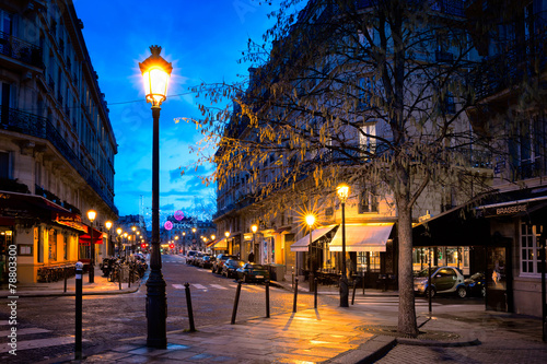 Paris beautiful street in the evening with lampposts