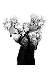 Double exposure of Businessman and trees using digital tablet