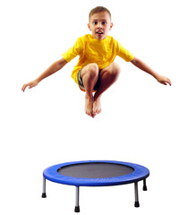 cute boy exercising and jumping on a trampoline