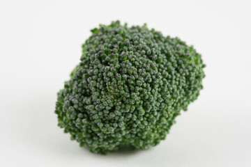 Piece of raw broccoli, isolated on white