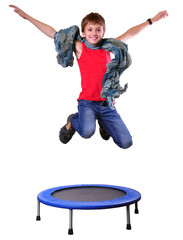 cute boy with scarf exercising and jumping on a trampoline