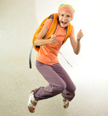 schoolchild with backpack jumping