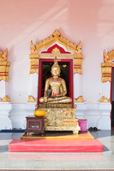 Thai old golden buddha statue in the temple