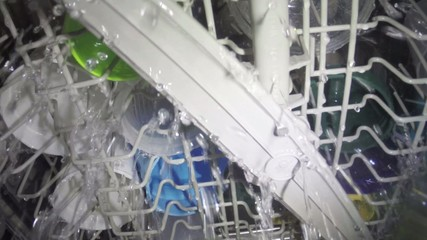Interior view dishwasher cleaning a full load of dishware